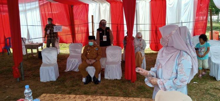 Didampingi Istri, Al Haris Mencoblos di TPS 36 Pematangkandis